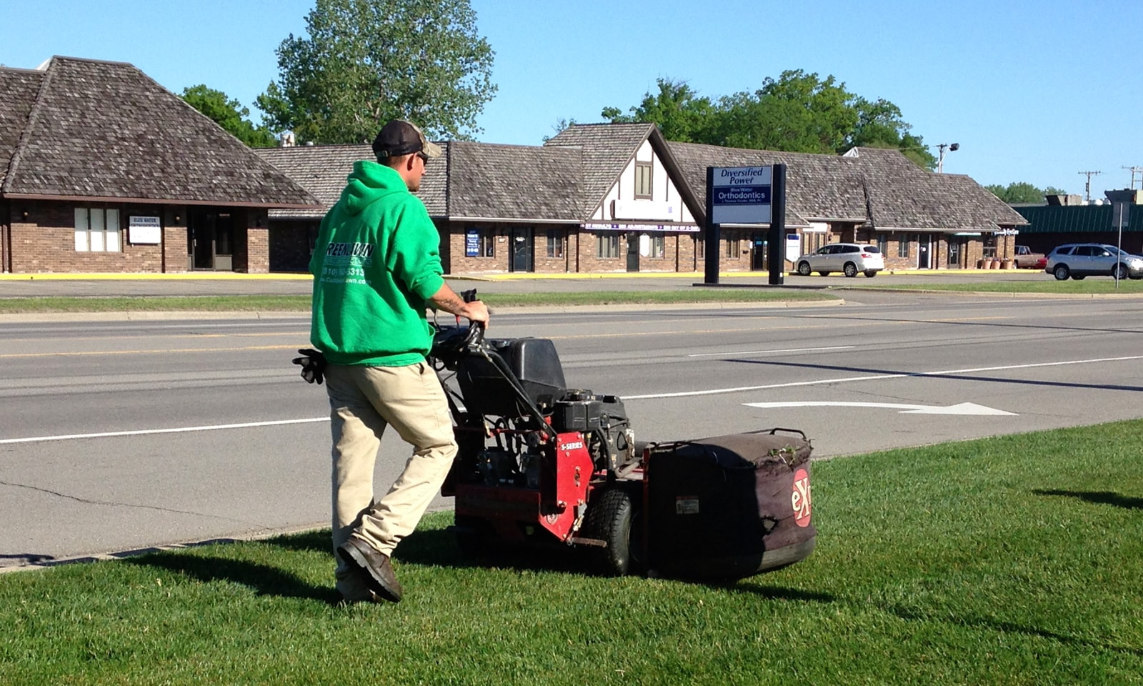 Greenlawn staff cutting lawn